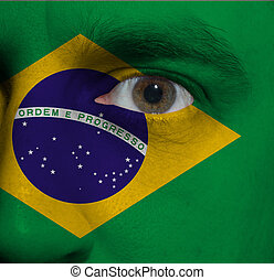 face with the Brazilian flag painted on it - close-up of a...