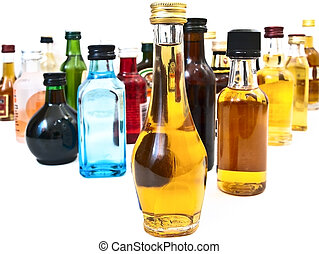 alcohol bottles - different alcohol bottles against the...
