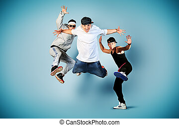 team dance - Group of modern dancers dancing hip-hop at...