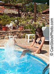 Splashing water at the poolside