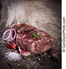 Premium Raw beef sirloin on wooden table