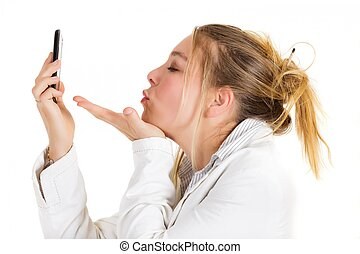 Sending kiss by phone - Blond business woman sending kiss by...
