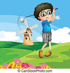 A boy playing golf