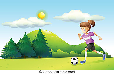 A girl playing soccer