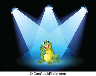 A frog on the stage with spotlights