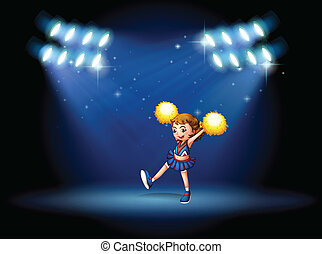 A cheerleader performing on the stage with spotlights
