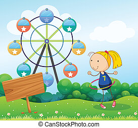 A girl playing with the hula hoop near the empty board -...
