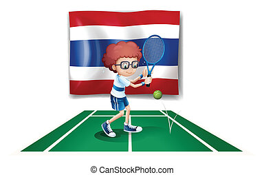 A boy playing tennis in front of the Thailand flag