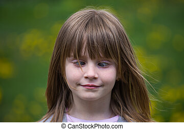 Cross-eyed young girl - Portrait cross-eyed young girl on...