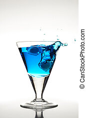 Blue Cocktail - Blue cocktail with an ice cube and a big...