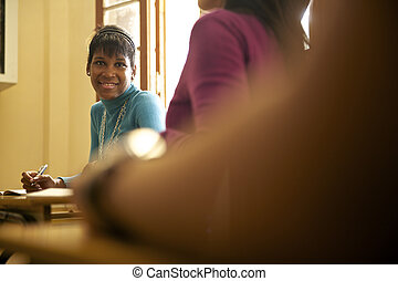 Students and high school education, portrait of black young woman during exam