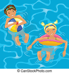 Two kids in water - Two cheerful kids swimming in the pool...