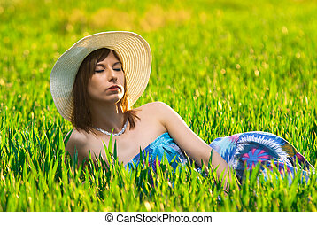 Beautiful girl relaxing in the Wheatfield