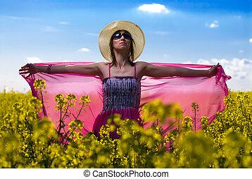 Beautiful woman relaxing in colza - Beautiful young woman...
