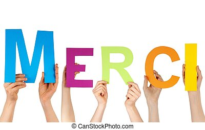 hands holding the letters MERCI - Hands hold the french word...