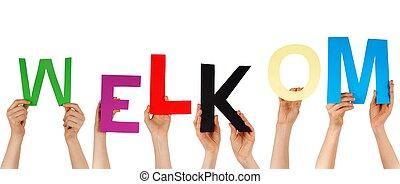 hands holding WELKOM - hands hold the dutch word WELKOM,...