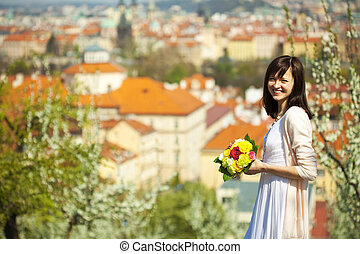 beautiful young bride on the background of Prague