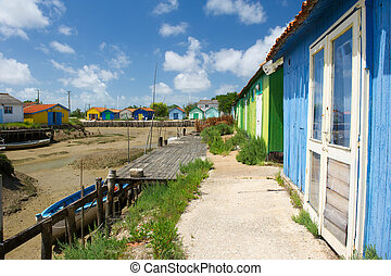 Colorful wooden cabins for oyster fishermen at Chateau de...