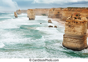 The Twelve Apostles in the rain, along the Great Ocean Road,...