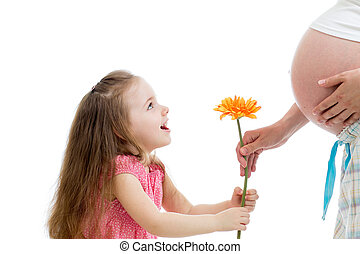 happy child gives  flower to pregnant mother