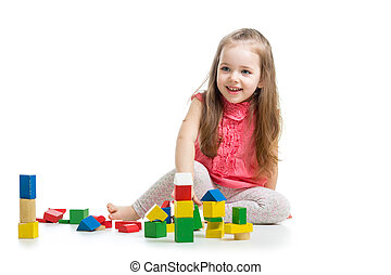 child girl playing with block toys over white background