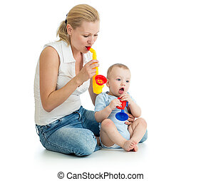 Mother and baby boy having fun with musical toys