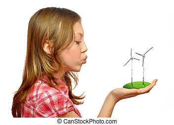 girl blowing on the wind turbines isolated on white