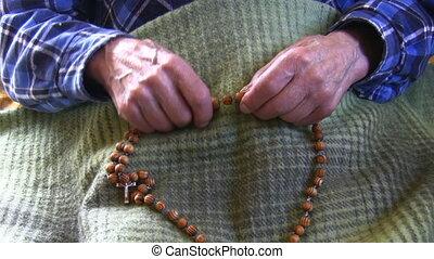 Old shaky wrinkled hands - Old wrinkled skin hands hold...
