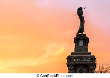Statue and Colorful Sky - A public statue in Mexico City at...