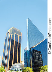 Shiny Skyscrapers - Two glass covered skyscrapers in a...