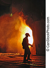 worker with hot steel inside of plant