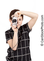 small boy photographing vertical with digital camera on...