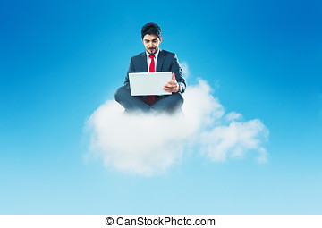businessman sitting on a cloud working with laptop cloud-computing concept