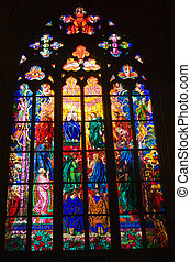 Stained glass windows of St. Vitus in Prague, Czech Republic.