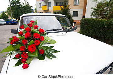Vintage wedding car decorated with roses