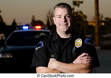 smiling officer - A smiling officer with his arms crossed in...