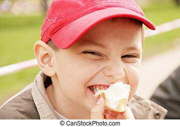 Boy eating ice-cream - Little boy eating ice-cream outdoors
