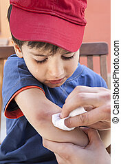 Scraped hand - Small boy crying in pain injuring his hand....
