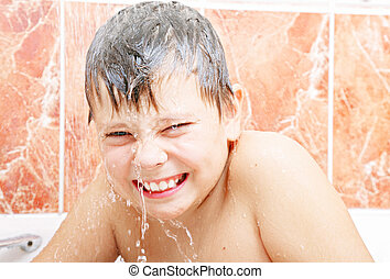 Cold shower - Funny boy in bath under cold water spurts...