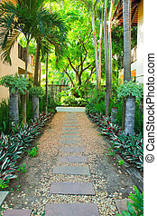 Stone pathway into tropical garden