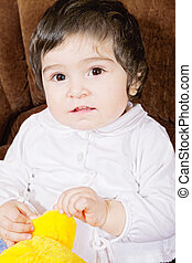 Baby with soft toy closeup photo