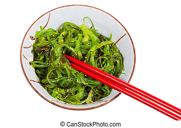 eating of chuka salad - seaweed salad