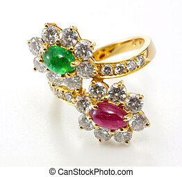 Golden Ring with Diamond and gemstone on white background.