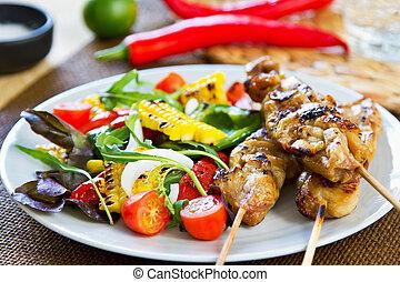 Grilled chicken skewer with salad - Grilled chicken skewer...