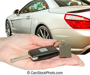 Female hand of new car owner holding auto keys isolated -...