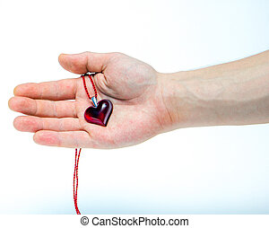 Heart shaped pendant - Red heart shaped pendant in mans hand...