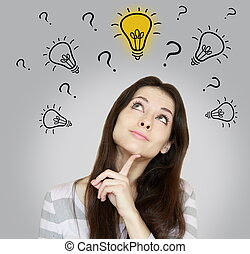Thinking woman making dicision with looking up on idea bulb...