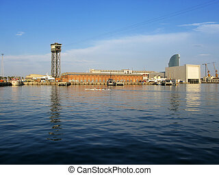 Barcelona Port: seaside view of Barceloneta harbors, and the old cable car tower