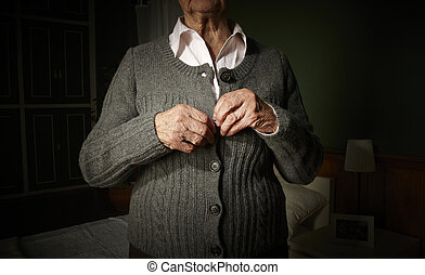 Old hands buttoning. - Old hands of an unrecognizable senior...