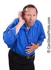 Senior Hearing Loss - Senile senior adult male cups his hand...